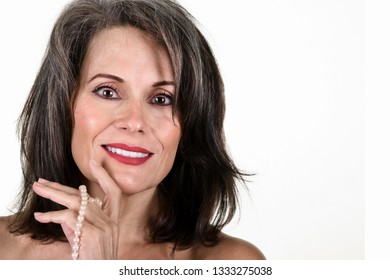 Portrait of a Beautiful Mature Woman with Pearl Necklace in Her Hand
