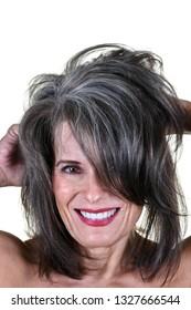 Portrait of a Beautiful Mature Woman Running Her Hands Through Her Hair