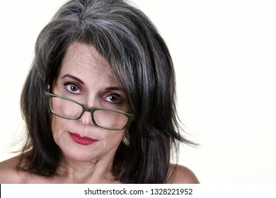 Portrait of a Beautiful Mature Woman Wearing Glasses Looking Serious