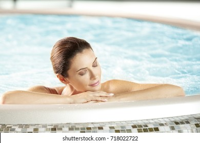 Portrait of a beautiful mid aged woman relaxing a me day in the hot tub