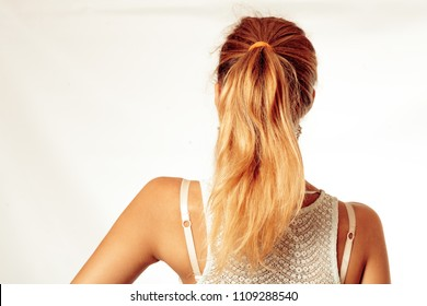 Portrait Of Beautiful Middle Age Blond Woman With Pony Tail Dyed Hair. Backside View Studio Shot.