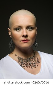 Portrait of beautiful middle age woman sad patient with cancer with shaved head without hair, hope in healing. She lost her hair