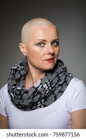 Portrait of beautiful middle age woman sad patient with cancer with shaved head without hair, hope in healing.