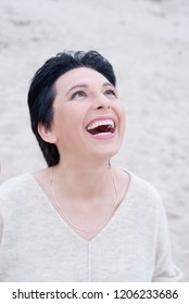 Portrait of beautiful middle aged woman on the Beach, selective focus, happiness concept