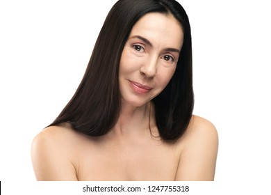 Portrait of beautiful middle aged woman on white background