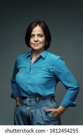 Portrait of beautiful middle aged woman wearing blue shirt