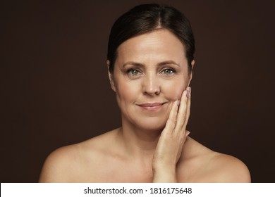 Portrait of a beautiful middle aged woman with clean wrinkled skin