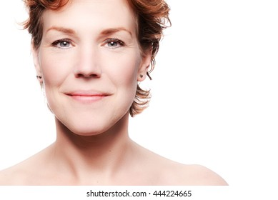 Portrait of a beautiful middle aged woman. Beauty and anti age concept. White background.