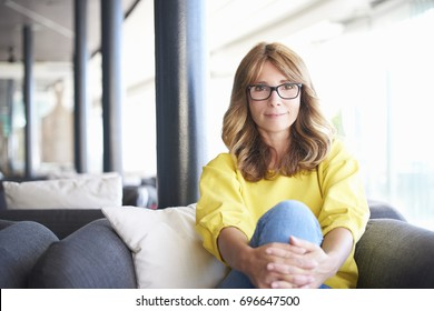 Portrait of a beautiful middle aged woman sitting in a coffee shop.