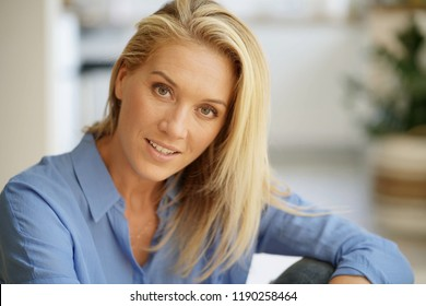 Portrait of beautiful middle-aged blond woman