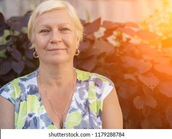 Portrait of a beautiful middle-aged woman outdoors. Selective focus.