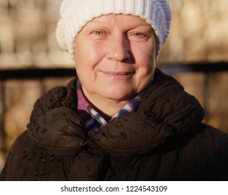 Portrait of a beautiful middle-aged woman outdoors. Selective focus. Color toned.