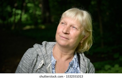 Portrait of a beautiful middle-aged woman in the park.