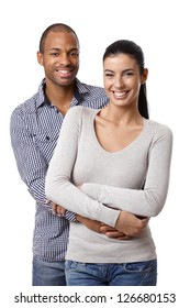 Portrait of beautiful mixed race couple, embracing, smiling, looking at camera.
