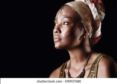 Portrait of a beautiful model in afro punk style. Makeup.