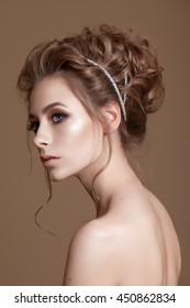 Portrait of beautiful model with big  eyes on brown background. Bridal makeup and hairdo