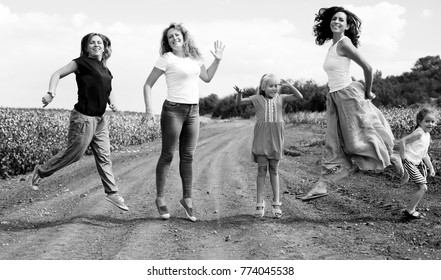 Portrait of beautiful mothers with kids outdoors
