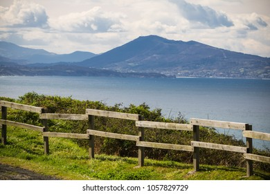 portrait of beautiful mountain jaizkibel rising above atlantic ocean, basque country, france