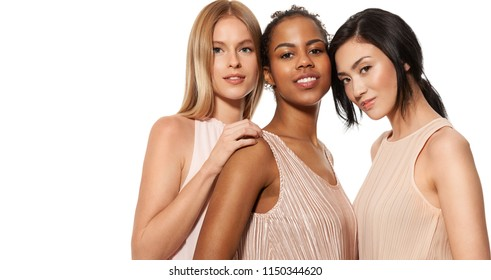 Portrait of beautiful multiracial young women with different  skin. Happy african-american young woman in centre with asian and caucasian girls on side. Isolated on white background