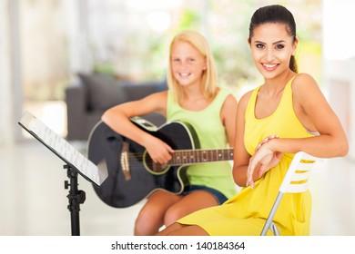 portrait of beautiful music tutor and student