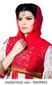 portrait of a beautiful muslim bride in red dress