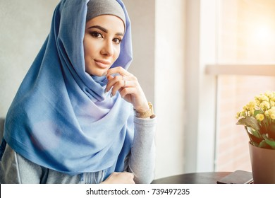 Portrait of a beautiful Muslim woman in cafe
