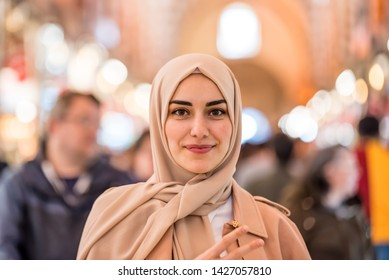 Portrait of beautiful Muslim woman in headscarf and fashionable modern clothes looking at camera.Modern Muslim women lifestyle business or travel tourist concept