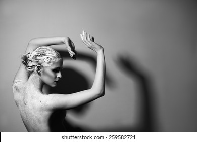 Portrait of the beautiful naked woman. Black and white photography. Body care. Spa. Mask of clay