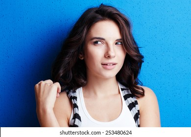 Portrait of a beautiful natural girl on a blue background.