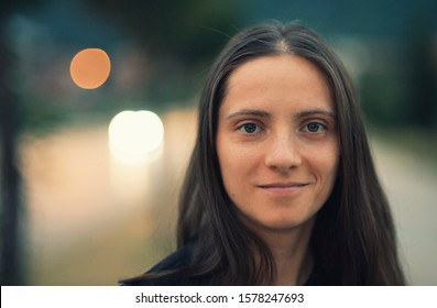 Portrait of a beautiful natural looking young woman with no make up