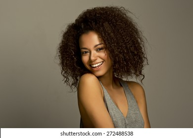 Portrait of a beautiful natural young African woman smiling happiness