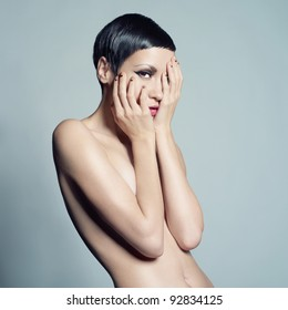 Portrait of beautiful nude lady with short hair
