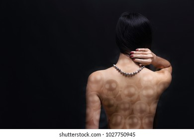 Portrait of beautiful nude long straight black hair woman with pearl necklace accessories. Naked sexy girl with smooth skin on her body over dark background, not show face, double exposure