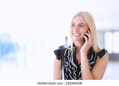 Portrait of a beautiful office worker talking on the phone
