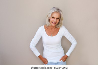 Portrait of beautiful older woman standing and smiling