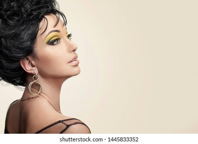 Portrait of beautiful oriental woman with hairstyle and holiday makeup