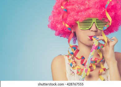 Portrait of beautiful party woman in pink wig and green glasses