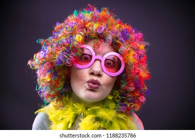 Portrait of beautiful party woman in wig and glasses Carneval
