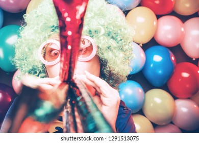 Portrait of beautiful party woman in wig and glasses (Carneval)