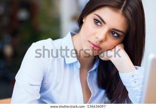 Portrait of a beautiful pensive businesswoman looking away