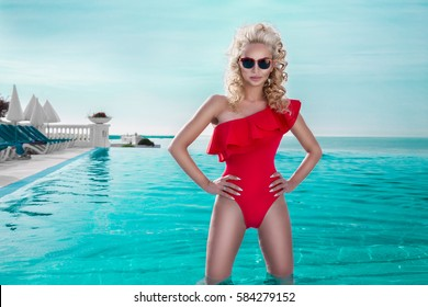Portrait beautiful phenomenal stunning elegant sexy blonde model woman with perfect face wearing a sunglasses lies in a pool with elegant lace outfit on amazing view  in Cannes, France