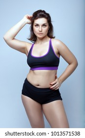 Portrait of a beautiful plump girl in sportswear.