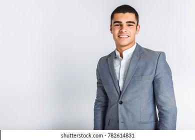 Portrait of the beautiful posing in a Studio. White background, isolated. Stylish business man