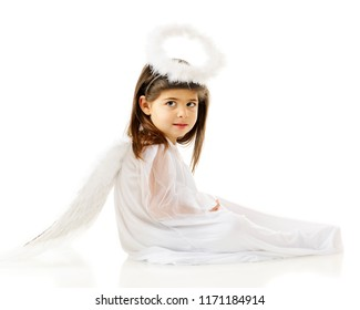 """Portrait of a beautiful preschool-aged """"angel"""" with halo, feathered wings and a white gown.  On a white background."""