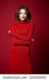 Portrait of a beautiful pretty woman in red lipstick