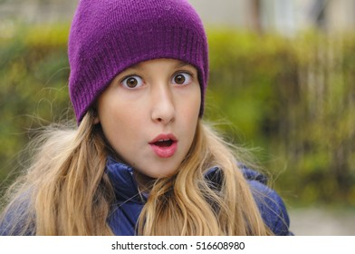 Portrait of Beautiful puberty looking at camera, wearing knitted cap, casual wardrobe, in autumn forest, soft, colorful, vivid and swirl background, manual lens used, looking at camera