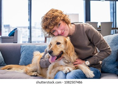 Portrait of beautiful red hair woman hugging her dog and smiling