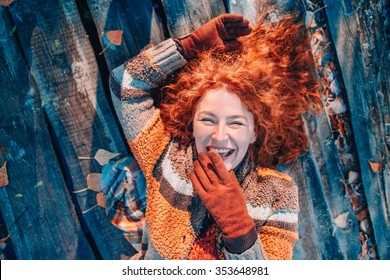 portrait of beautiful redhaired girl smiling