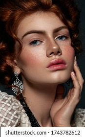 Portrait of a beautiful red-haired girl with an ultra fashionable Victorian haircut. Bohemia. Nude makeup. luxury jewelry.