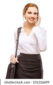 portrait of beautiful red-haired girl in white blouse with laptop bag making phone call